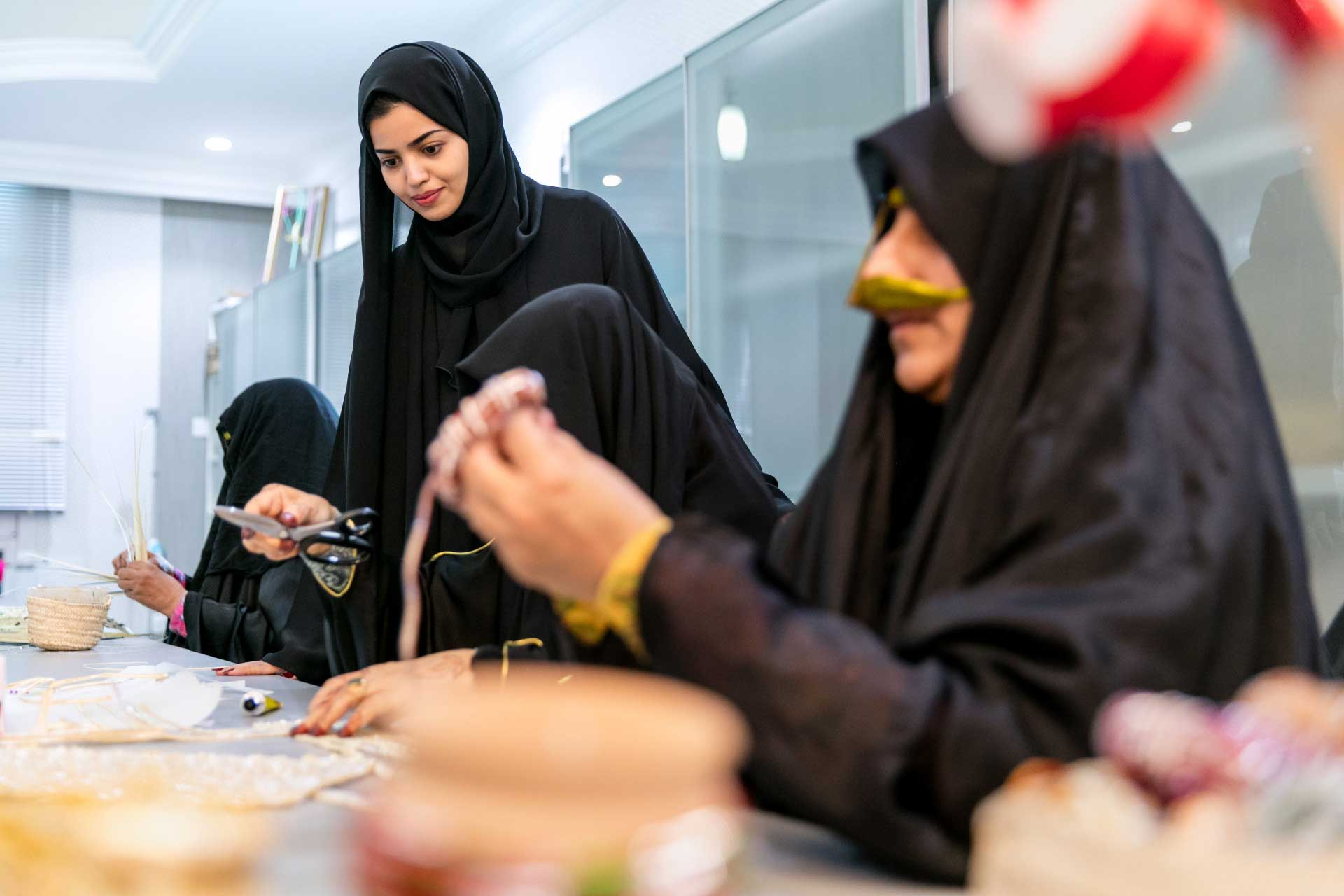 Woman at work at the Al Ghadeer UAE Crafts centre